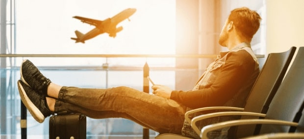 An international student is sitting at the airport and looking forward to charter a plane to study in Australia.