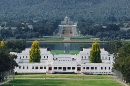 The parliament in Canberra with its beautiful gardens surrounded.