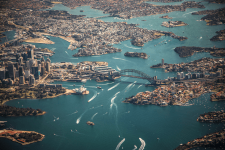 Sydney harbour air shoot with boasts and ferries crossing the waterways.